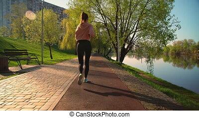 jogging, femme, vue, dos, dehors