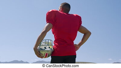joueur football américain, casque, debout