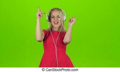 lent, écouteurs, danse, mouvement, sexy, girl, robe, rouges