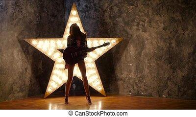 lent, étoile, électrique, danse, guitare, arrière-plan., mouvement, silhouette, girl, briller