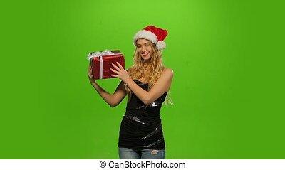 lent, casquette, gift., screen., mouvement, femme, vert, blonds, noël