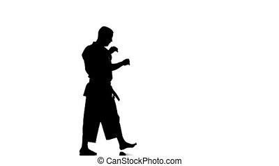 lent, silhouette, motion., exercisme, contre, karaté, arrière-plan., blanc, homme