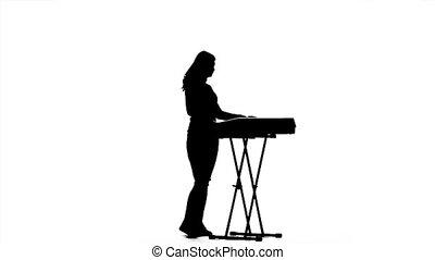 lent, silhouette, musicien, mouvement, piano., girl, électronique, jouer