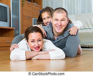 maison heureuse, famille, trois