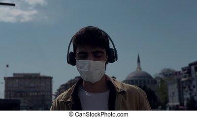 masque portant, écouteurs