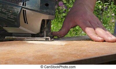 menuisier, électrique, charpentier, fabrication, action., panel., meubles, réparation, charpenterie, gigue, coupures, puzzle, haut, scier, planche, bois, fin, travaux, fretsaw., artisan, house., saw., tools.