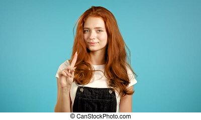 nier, gesture., ne pas être d'accord, faire, non, arrière-plan., fille femme, rejeter, signe, négation, portrait, joli, désapprouver, doigt, bleu