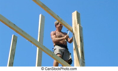 ouvrier construction, marteler