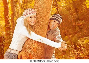 parc, couple heureux, automne