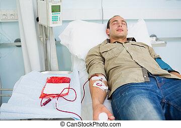patient, transfused, yeux fermés