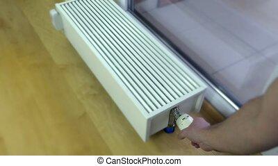 personne, température, main, radiateur, ajustement, thermostat