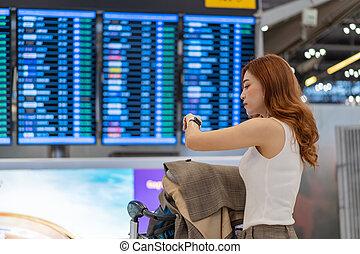 planche, regarder, montre, aéroport, intelligent, vol, elle, femme, information