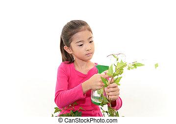 plante, fille souriante