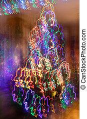 résumé, fantaisie, néon, pendre, arbre noël, vertical, brouillé, incandescent, garlands., arrière-plan.