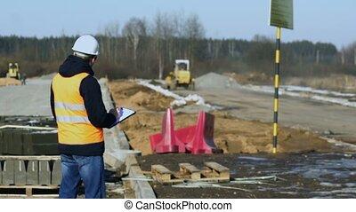 roadbed, écrit, matériel, pose, trottoir, construction, regarde, phase, pendant, inspecteur, ingénieur, données, ou, route, avant