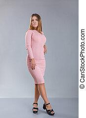 rose, peu, femme, non-standard, figure, habillé, tricoté, dress., croissance, bas, modèle, ou