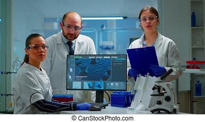 séance, équipe, laboratoire, scientifiques, appareil photo, regarder