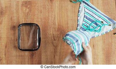 sac, bikini, mains, emballage, maillot de bain