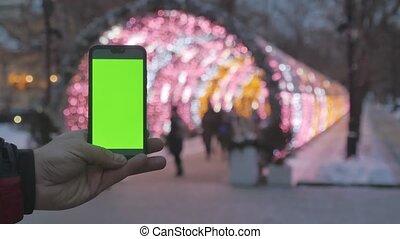 smartphone, coloré, screen., année, foyer., fond, vert, guirlandes, nouveau, dehors