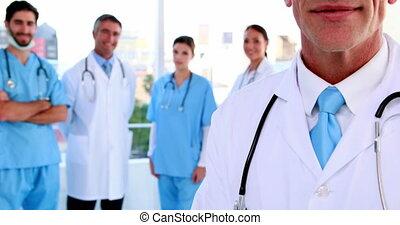 sourire, équipe, docteur, appareil photo