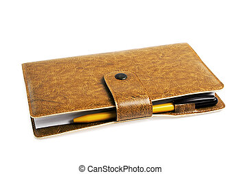 stylo, cahier, fond blanc