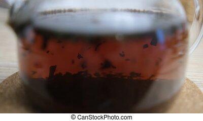 swirl., thé, thé, arrière-plan., brassé, 4k, ébullition, water., théière, gros plan, brouillé, tea., cérémonie, brassage, processus, feuilles, fort, verre