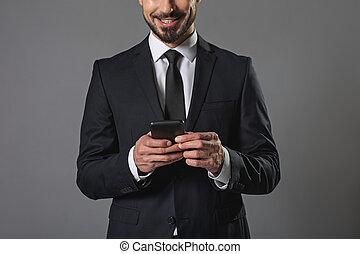 téléphone portable, dactylographie, homme affaires, sourire, message