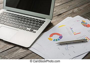 table, ordinateur portable, financier, diagrammes