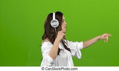 tourbillon, autour de, écran, écouteurs, par, vert, musique, girl, écoute, elle.