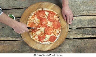 vue., découpage, sommet, main, pizza