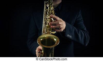 vue, devant, closeup, joueur saxophone
